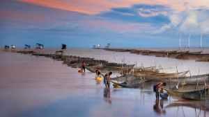 men preparing their boats for fishing