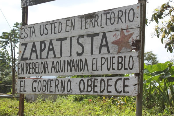"""Signs such as these stand in towns along the road from San Cristobal to Palenque. """"You are in Zapatista rebel territory. Here the people command and the government obeys."""""""