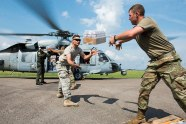 Sailors_and_Soldiers_load_water_onto_an_MH-60S_Sea_Hawk_helicopter._(37044691925)
