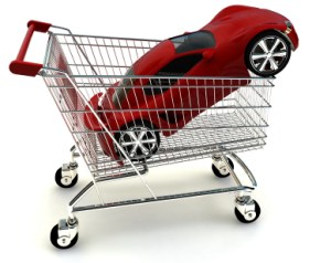 A red sports car in a shopping cart