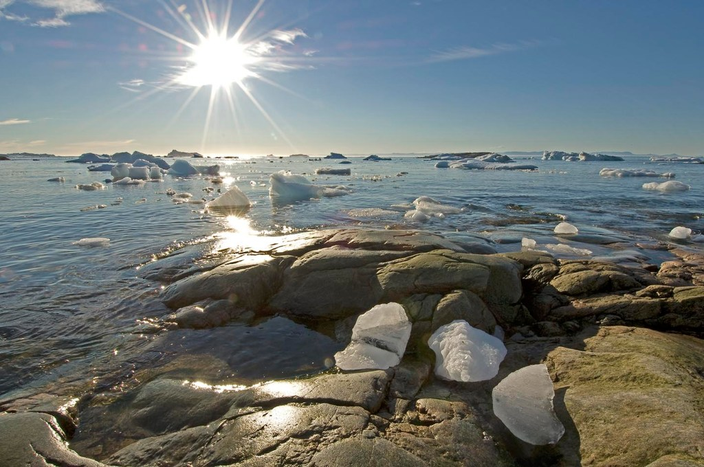 Disko bay Ilulissat ice brash and rocks and sunflare 081907_8 DSC_0040 090312