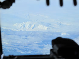 The IceBridge team also flew over Peter I Island, a relatively unstudied island off the Antarctic coast. Photograph courtesy Ted Scambos.