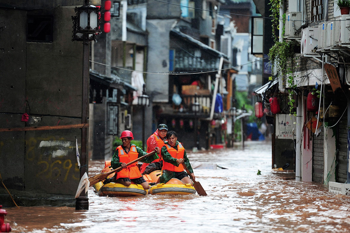 Rescue workers search for people on a flooded street. Reuters