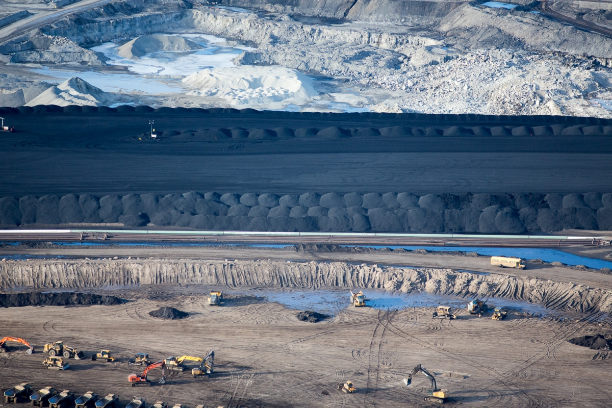 "Suncor Oil Sands Project. Piles of uncovered petrolum coke, a byproduct of upgrading tar sands oil to synthetic crude. ""Petcoke"" is between 30-80 per cent more carbon intense than coal per unit of weight."