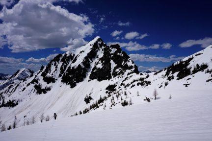 Kylie climbs beneath Saska Peak.