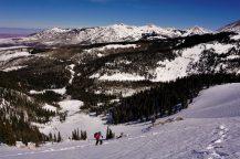 Kylie climbs up long snowfields.