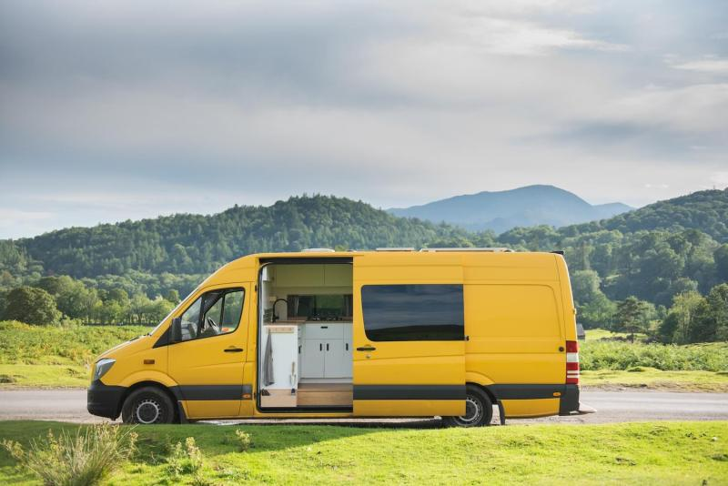 big yellow sprinter campervan with beautiful kitchen in lake district