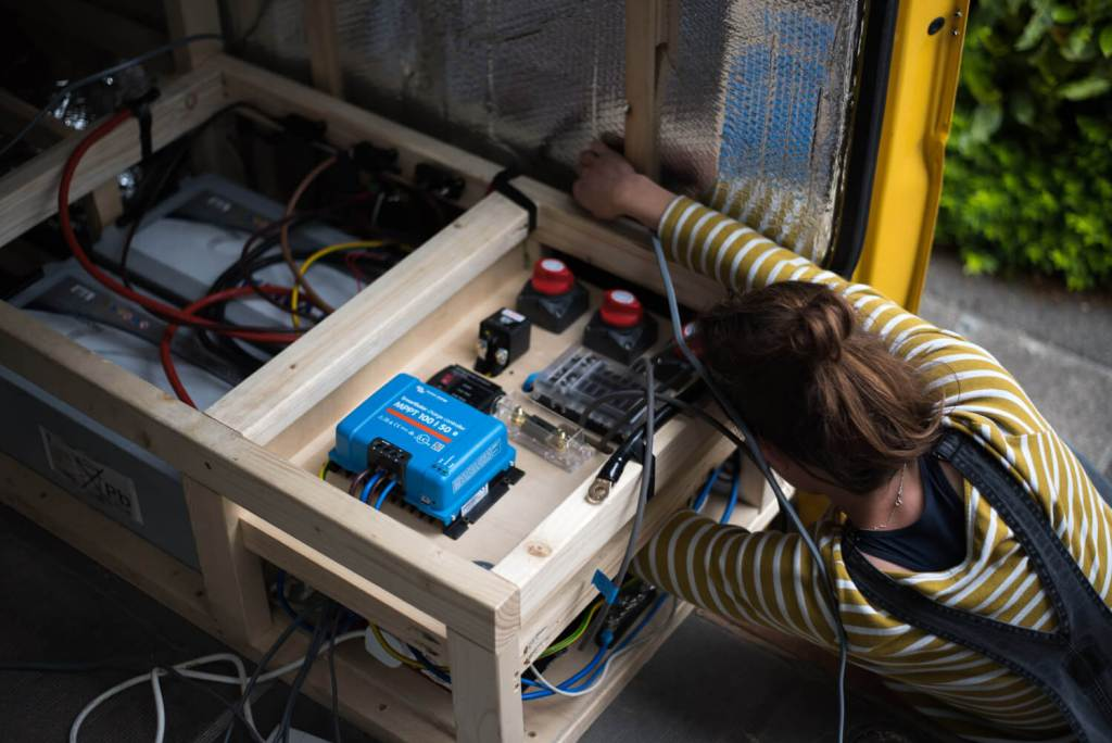 girl wiring a camper van electrical system