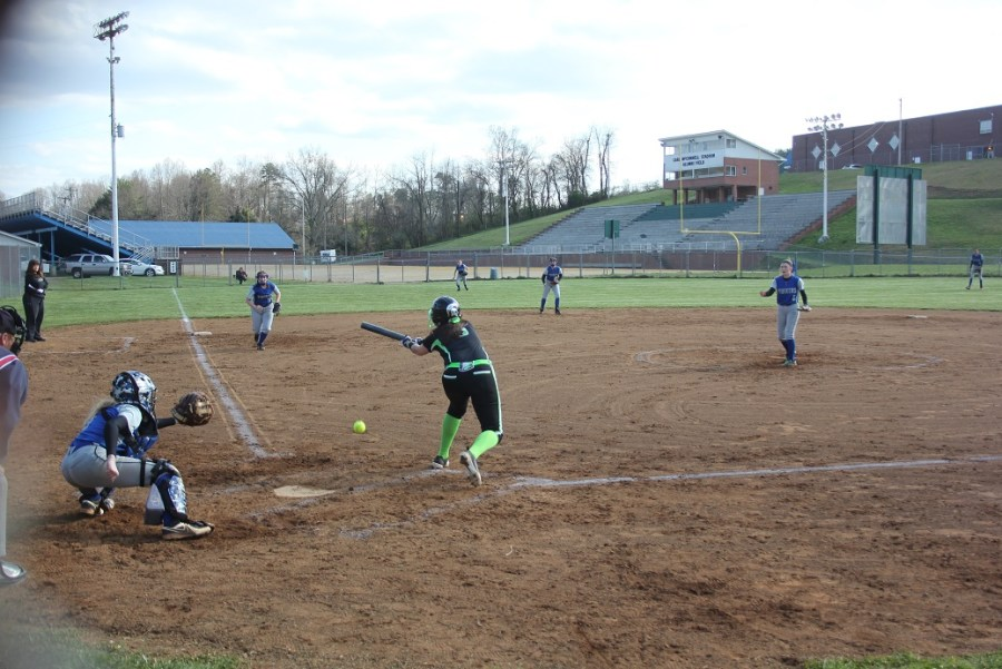 04-10-2018 Eastside's Lexie King drops a bunt single in Eastside vs Thomas Walker game