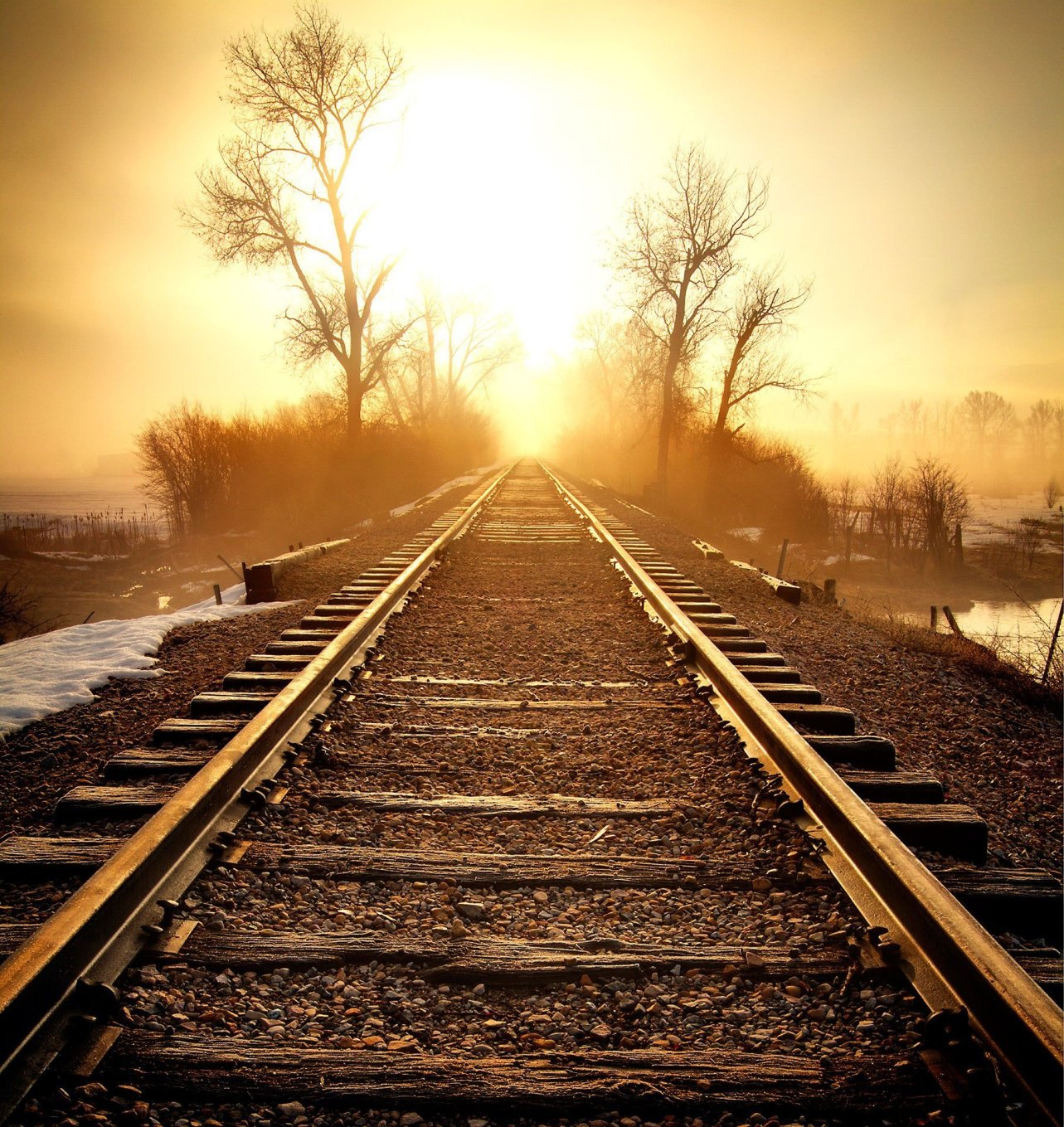 Railroad tracks into the early morning sun