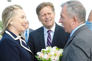 Clinton is greeted by Vice-Governor of St. Petersburg Oleg Markov as US Ambassador to Russia Michael McFaul looks on in St. Petersburg, Russia, on June 28, 2012.