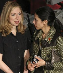 Chelsea Clinton and Huma Abedin chat while on the campaign trail in 2008. (Credit: Reuters)