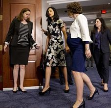 Huma Abedin, center, a longtime aide to Democratic presidential candidate Hillary Rodham Clinton, returns to a hearing room on Capitol Hill in Washington, Friday, Oct. 16, 2015, after a break in hearing testimony during a closed-door hearing of the House Benghazi Committee. (AP Photo/Jacquelyn Martin)
