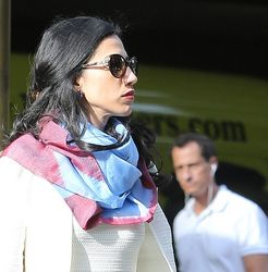 Abedin and Weiner leave their home separately, the day before the sexting scandal broke in September, 2016. (Credit: The Daily Mail)