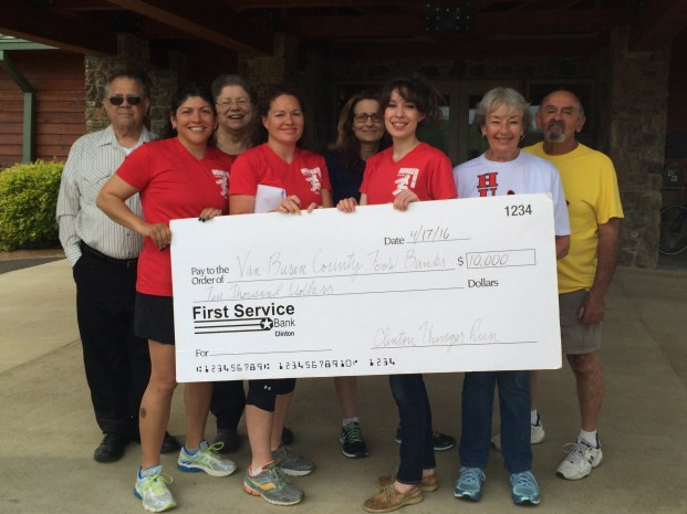 Volunteers present $10,000 to the VBC Food Banks (Left to Right: Scott Spencer, Elisa McKinney, Betty Spencer, Director Meagin Warren, Debbie Lawrence, Jessica Crabtree, Karin & Claude Ruiz