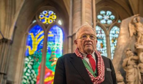 David Hockney in front of The Queen's Window, stained glass window at Westminster Abbey he designed (Victoria Jones/PA)