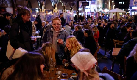 Londoners enjoy drinks in outside areas of pubs after restrictions are relaxed on 12 April.Credit: Tolga Akmen/AFP/Getty