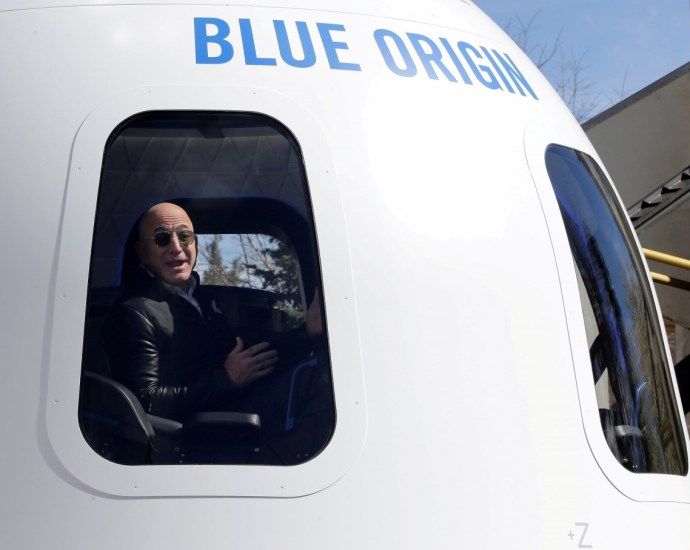 Amazon and Blue Origin founder Jeff Bezos addresses the media about the New Shepard rocket booster and Crew Capsule mockup at the 33rd Space Symposium in Colorado Springs, Colorado, United States April 5, 2017. (Reuters/Isaiah J. Downing/File Photo)