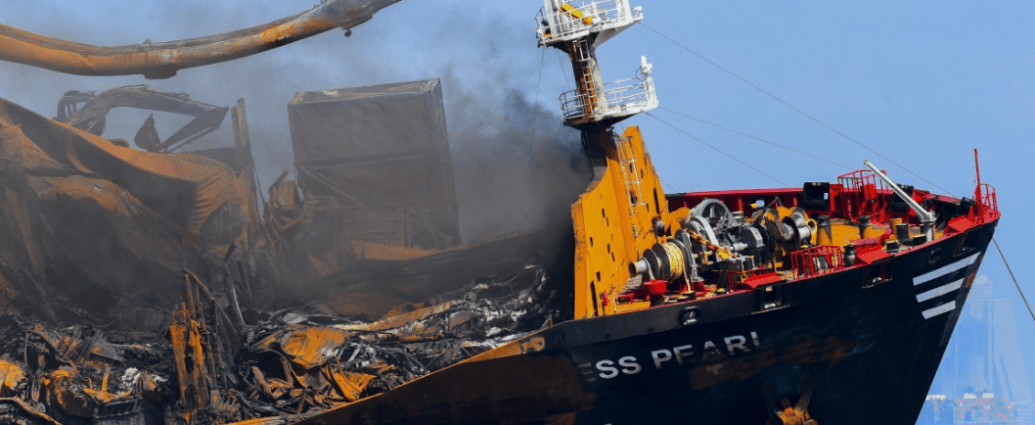 Smoke billows from the Singapore-registered container ship MV X-Press Pearl. [Ishara S Kodikara/AFP]