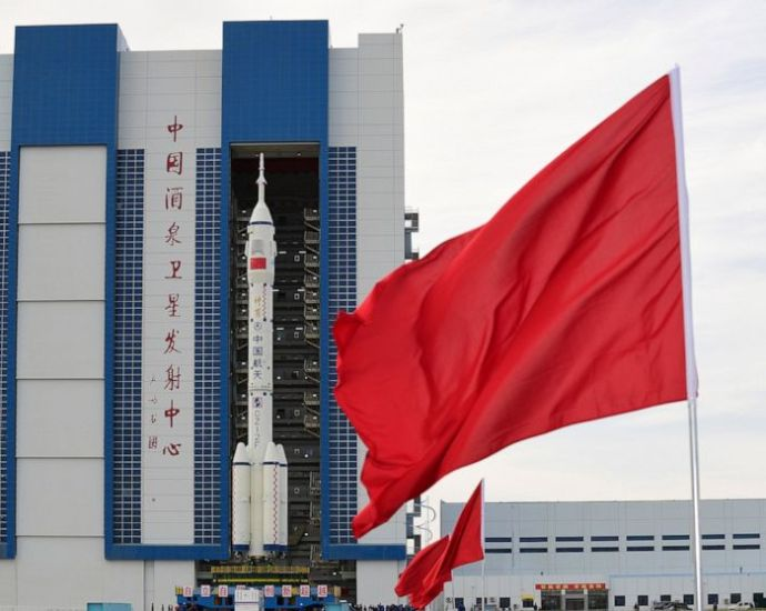 In this photo released by Xinhua News Agency, the Shenzhou-12 manned spaceship with its Long March-2F carrier rocket is being transferred to the launching area of Jiuquan Satellite Launch Center in northwestern China's Gansu province, on Wednesday, June 9, 2021. A three-man crew of astronauts will blast off in June for a three-month mission on China's new space station, according to a space official who was the country's first astronaut in orbit in May. (Wang Jiangbo/Xinhua via AP)