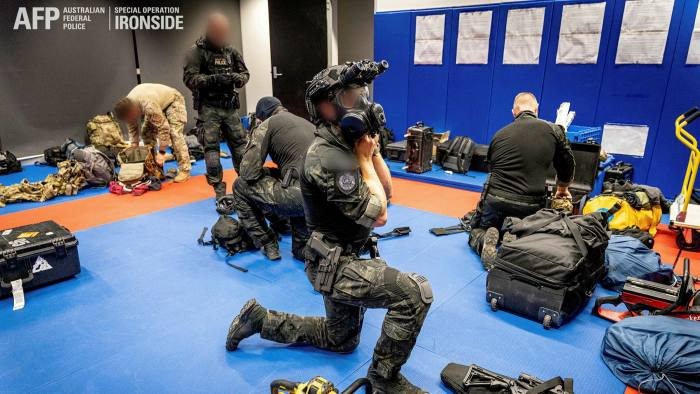 Members of the Australian Federal Police are seen during Operation Ironside against organised crime. Ironside is the Australian counterpart of the global covert operation © Australian Federal Police/Handout via REUTERS