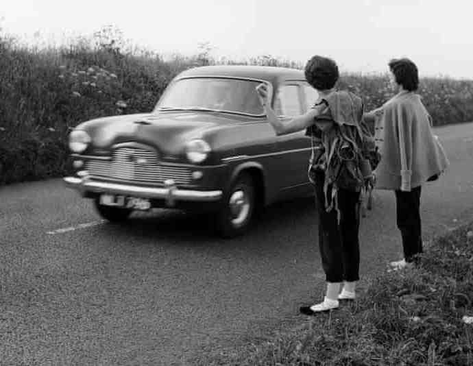 Young women hitch-hike on country lanes, 1956. Photograph: Harry Kerr/Getty Images