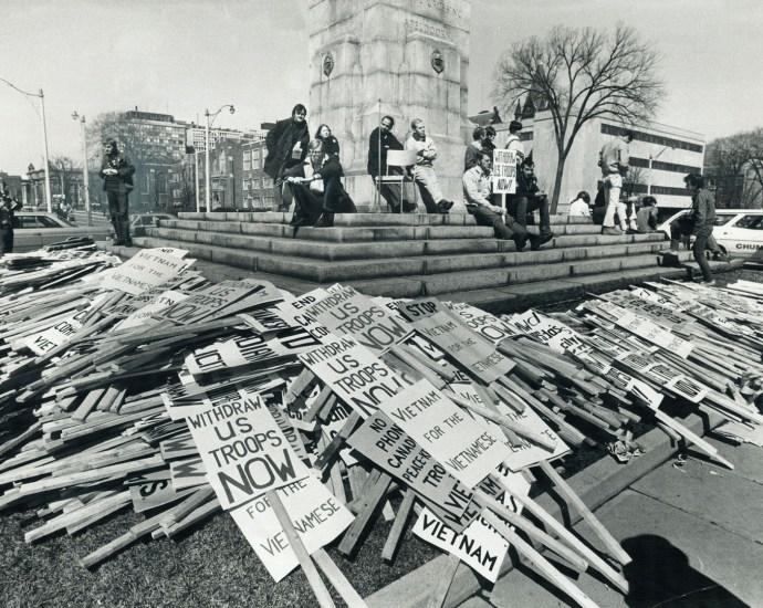 Title: Anti-Vietnam War placards surround Toronto's war memorial in 1969. Photographer: Reg. Innell Date: April 6, 1969