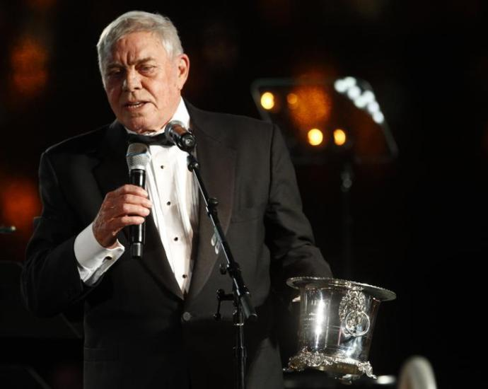"""FILE - In this Tuesday Oct. 30, 2012 file photo, Tom T. Hall accepts the Icon Award at the 60th Annual BMI Country Awards in Nashville, Tenn. Singer-songwriter Tom T. Hall, who composed """"Harper Valley P.T.A."""" and sang about life's simple joys as country music's consummate blue collar bard, has died. He was 85. His son, Dean Hall, confirmed the musician's death Friday, Aug. 20, 2021 at his home in Franklin, Tennessee. (Photo by Wade Payne/Invision/AP, File)"""