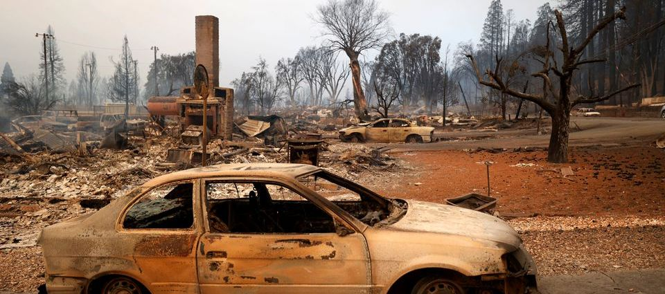 View of a burned car at the Dixie Fire, a wildfire that tore through the town of Greenville, California, U.S. August 5, 2021. REUTERS/Fred Greaves