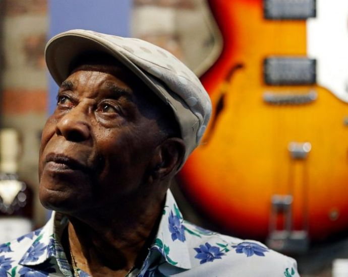 """Buddy Guy poses for a portrait to promote the latest installment of the PBS biography series, """"American Masters"""" on Wednesday, July 28, 2021, at his blues club Buddy Guy's Legends in Chicago. (AP Photo/Shafkat Anowar)"""