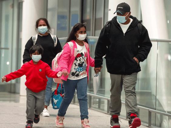 Supun Kellaptha, Nadeeka Kuttige and their children Sethmundi and Dinath arrive in Toronto on Tuesday September 28, 2021. PHOTO BY PETER J. THOMPSON/NATIONAL POST