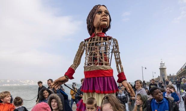 Little Amal walks along Folkestone pier. Photograph: Dan Kitwood/Getty Images