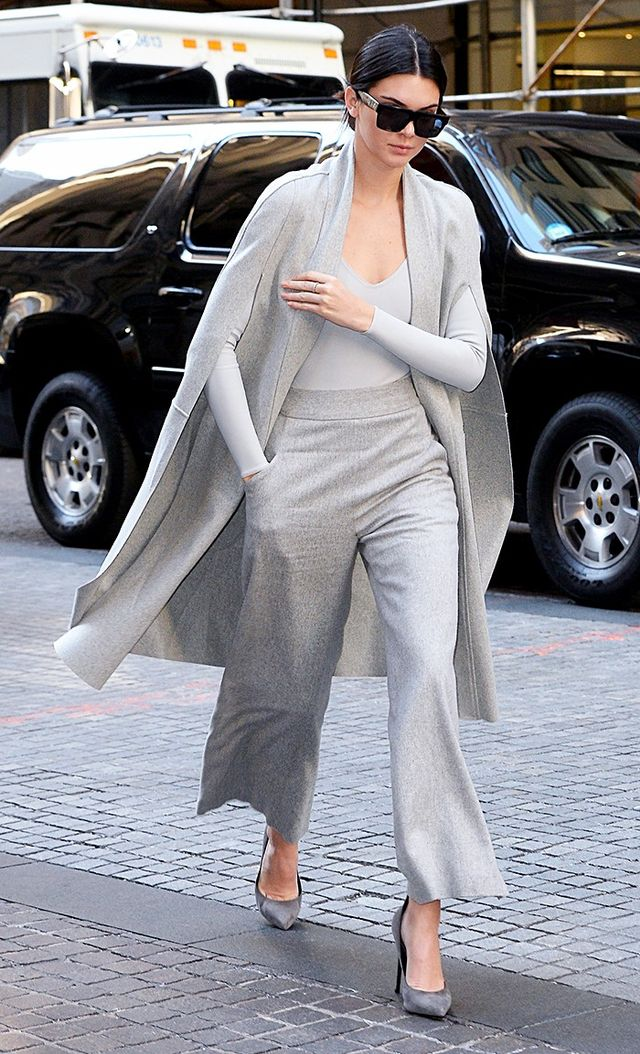 On Jenner: Celine sunglasses; Sally LaPointe Cashmere Cape with Detachable Fox Stole ($7250); Atea Oceanie L/S Crawford Neoprene Bodysuit ($240); Sally LaPointe trousers;...