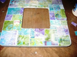 Adhere canvas pieces with ModPodge