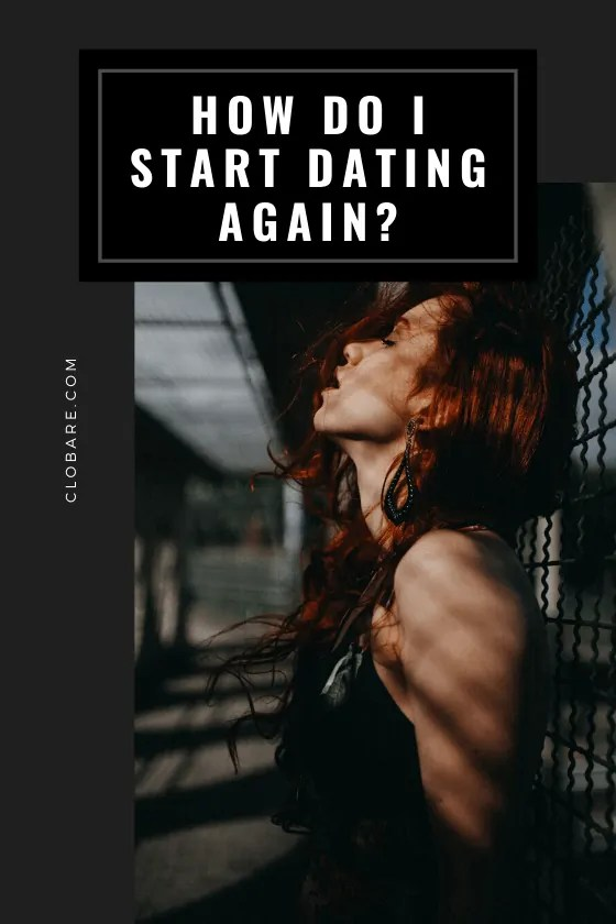 """Woman leans her head against a chainlink fence with her red hair blowing around her as she thinks """"how do I start dating again?"""""""