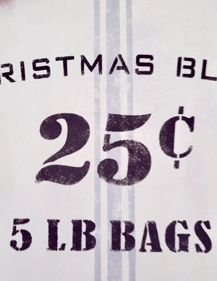 Christmas sign after stenciling the words and .25.