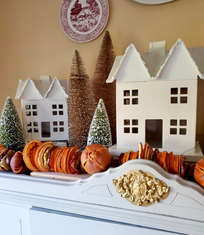 Dried fruit garland with bottle brush trees and white houses