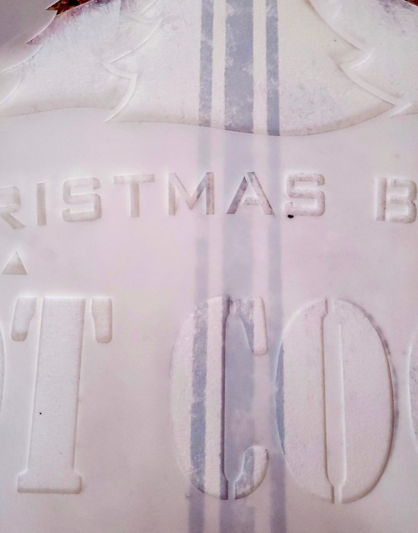 Christmas signs with the stencil on top