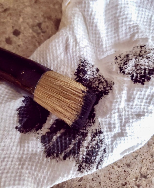 off loading paint from stencil brush