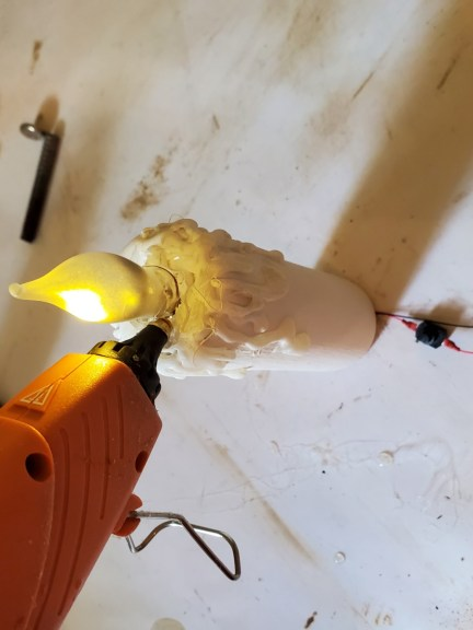 adding the glue around the bulb to hold it in tightly