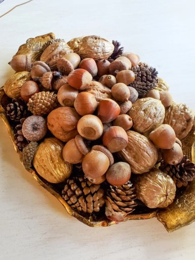 A Florentine tray filled with nuts for fall decor