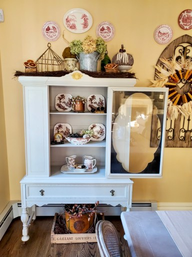 The hutch open with natural decor.  wreath is shared too for fall decor