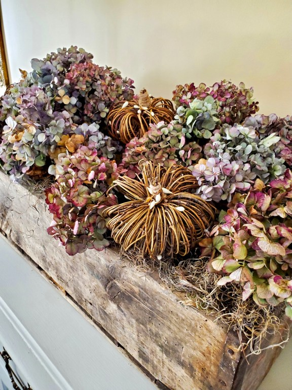 close up crate filled with dry hydrangea for natural fall decor