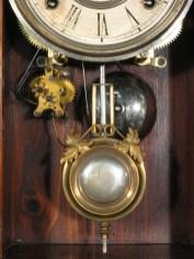 Pendulum, bell and alarm unit.