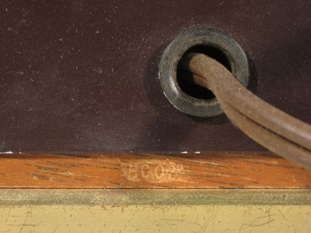 Date code 5002 on the wood beneath the power cord.
