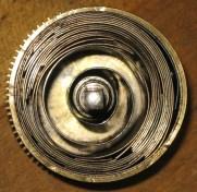 The broken mainspring still in the barrel