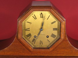 Printed brass dial, octagon shaped wooden bezel.