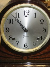 The aluminum dial with printed numerals.