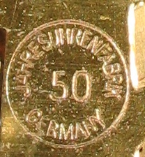 "Rear plate of movement says ""Jahresuhrenfabrik Germany 50"" in a circle"