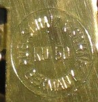 """Rear plate of the movement says """"Aug. Schatz & Sohne Germany KU 50"""" in a circle"""